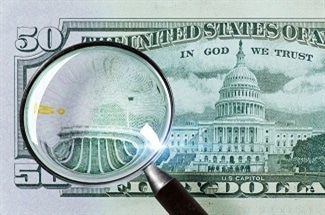 Preventing the Use of Counterfeit Money Using Quantum Physics